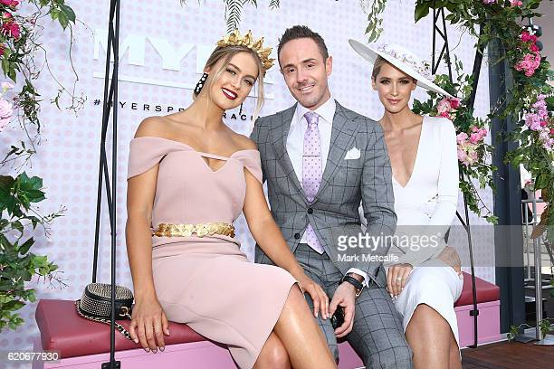 Stephanie Smith Donny Galella and Nikki Phillips pose at the Fashions On The Field Marquee on Crown Oaks Day at Flemington Racecourse on November 3...