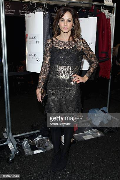 Stephanie Szostak prepares backstage at the Vivienne Tam fashion show during MercedesBenz Fashion Week Fall 2015 at The Theatre at Lincoln Center on...