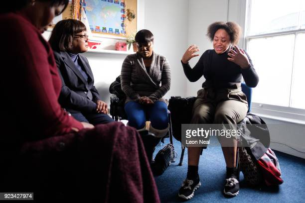 Stephanie Tonmi a former detainee at the Yarl's Wood Immigration Detention Centre reacts as she tells Shadow Home Secretary Diane Abbott about her...