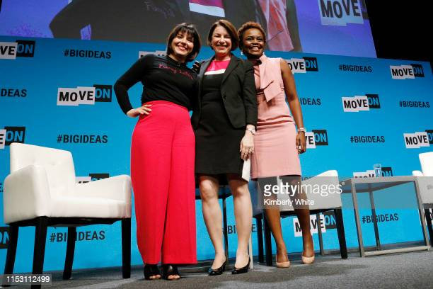 Stephanie Valencia Amy Klobuchar and Karine JeanPierre speak onstage at the MoveOn Big Ideas Forum at The Warfield Theatre on June 01 2019 in San...
