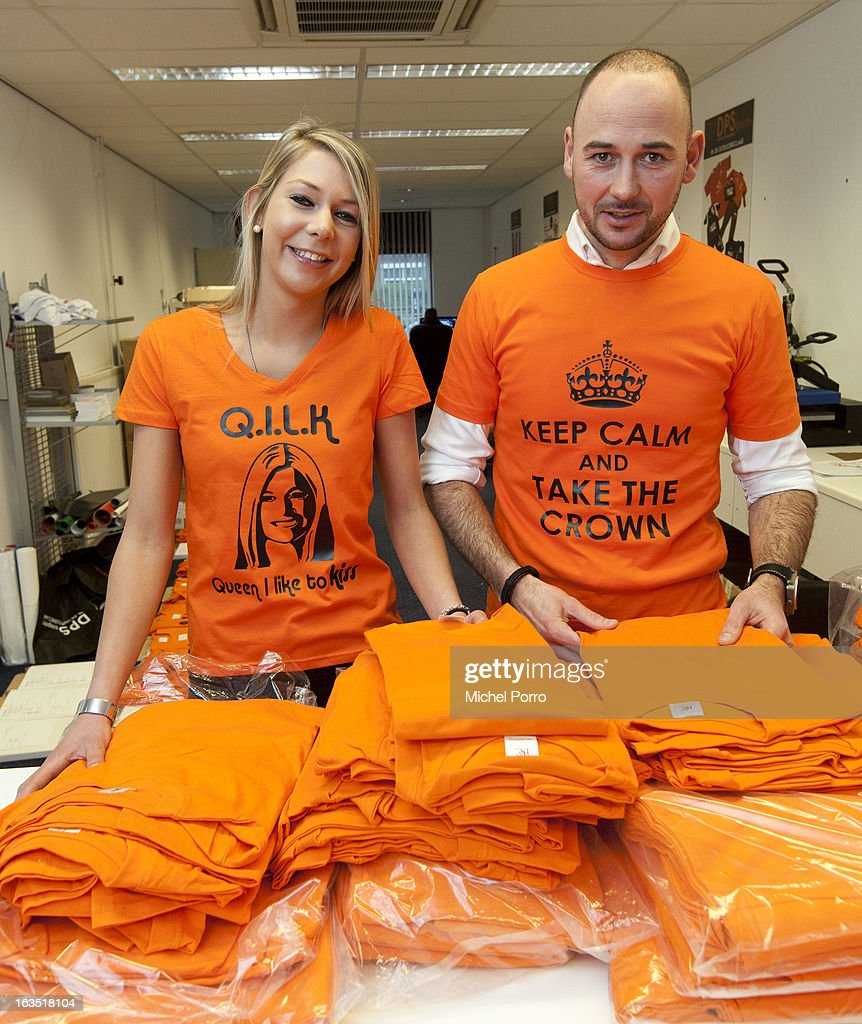 Stephanie van Oosterbosch and Wesley Koevoet prepare t-shirts to be printed with coronation messages designed by DPS Company on March 11, 2013 in Roosendaal, Netherlands.The shirts are for sale in preparation of the upcoming 30 April coronation of Crown Prince Willem Alexander of The Netherlands.