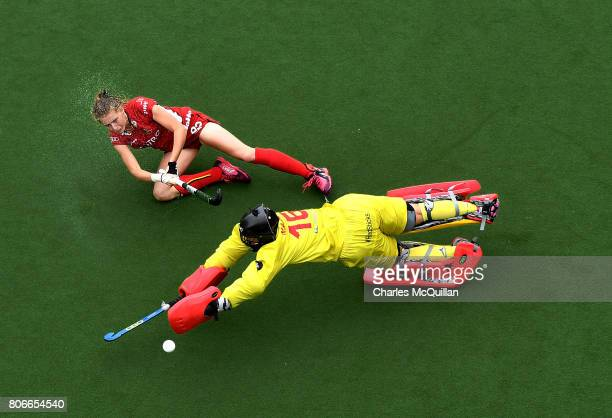 Stephanie Vanden Borre of Belgium scores past Maria Ruiz of Spain in a penalty shoot out during the Fintro Hockey World League SemiFinal 7/8th...
