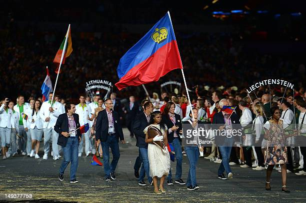 Stephanie Vogt of the Liechtenstein Olympic tennis team carries her country's flag during the Opening Ceremony of the London 2012 Olympic Games at...