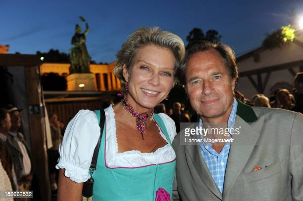 Stephanie von Pfuel and Hendrik teNeuss attend the Oktoberfest beer festival at Kaefer on September 23 2012 in Munich Germany