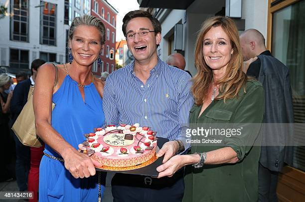 Stephanie von Pfuel Andreas Melcher Andrea Schoeller during the opening of the Grey's Bar at H'Otello on July 20 2015 in Munich Germany