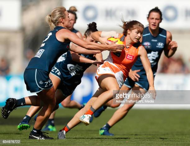 Stephanie Walker of the Giants is tackled by Katie Loynes of the Blues during the 2017 AFLW Round 02 match between the Carlton Blues and the GWS...
