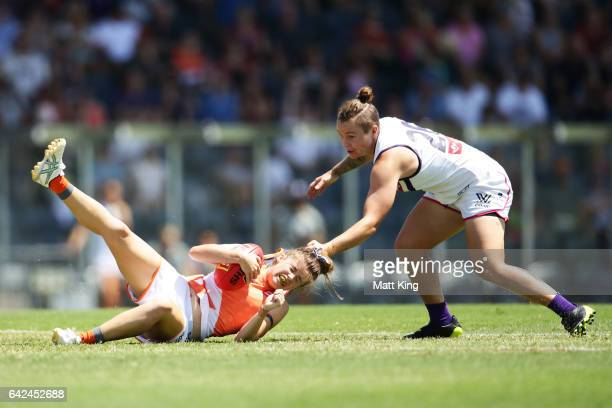 Stephanie Walker of the Giants is tackled by Taylah Angel of the Dockers during the Women's round three match between Greater Western Sydney Giants...