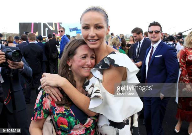 Stephanie Waller, wife of Chris Waller, hugs Christine Bowman after Winx won The Queen Elizabeth Stakes during day two of The Championships as part...