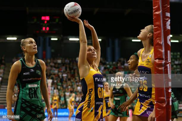 Stephanie Wood of the Lightning sets to shoot the ball during the round six Super Netball match between the Fever and the Lightning at HBF Stadium on...