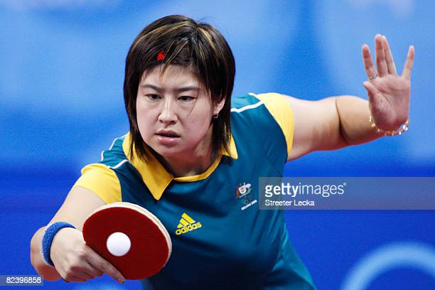 Stephanie Xu Sang of Australia hits a shot during their table tennis Women's Singles match at the Peking University Gymnasium on Day 10 of the...
