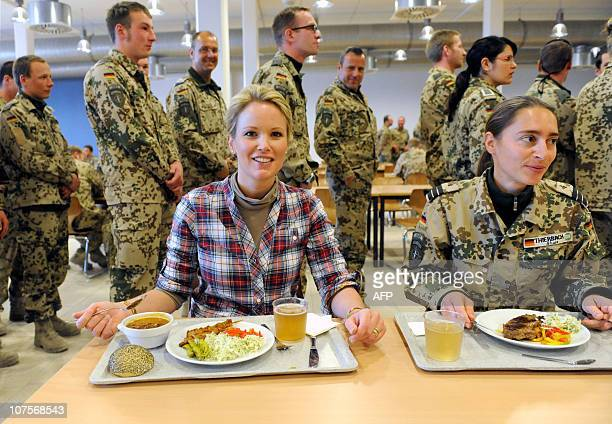 Stephanie zu Guttenberg wife of German Defence Minister KarlTheodor zu Guttenberg has a meal with a female soldier at the military Bundeswehr base of...