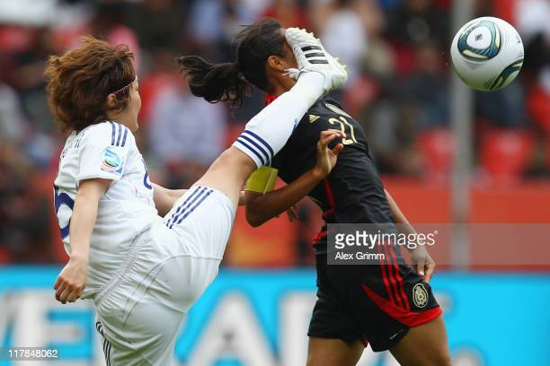 Stephany Mayor of Mexico is hit by Mizuho Sakaguchi of Japan during the FIFA Women's World Cup 2011 Group B match between Japan and Mexico at the...