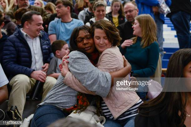 Stephany Spaulding hugs Cindy Sandhu during a candlelight vigil at Highlands Ranch High School on May 8 2019 in Highlands Ranch Colorado One student...