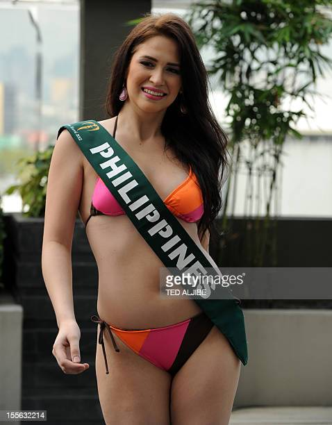 Stephany Stefanowitz of the Philippines poses for photographers during a press presentation of the Miss Earth beauty pageant at a hotel in Manila on...
