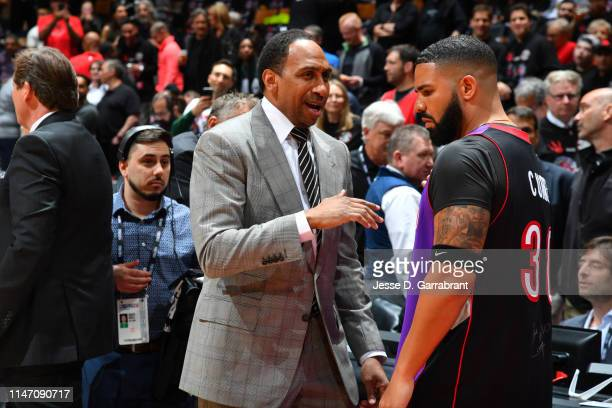 Stephen A. Smith and Rapper, Drake, talk prior to a game between the Golden State Warriors and the Toronto Raptors during Game One of the NBA Finals...
