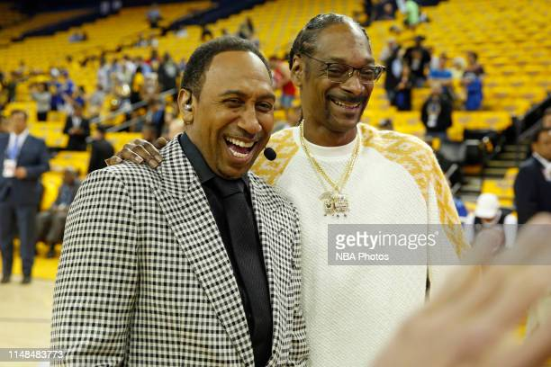 Stephen A Smith poses for a photo with Snoop Dogg on court before Game Four of the NBA Finals between the Toronto Raptors and the Golden State...
