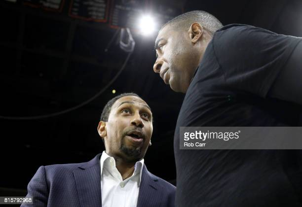 Stephen A Smith speaks to Cris Carter during week four of the BIG3 three on three basketball league at Wells Fargo Center on July 16 2017 in...