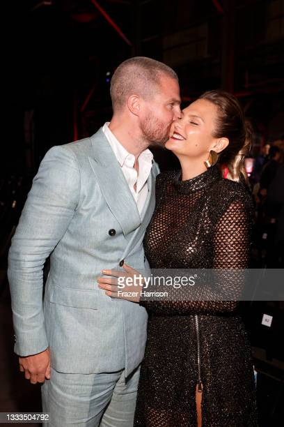 """Stephen Amell and Cassandra Jean are seen as STARZ celebrates the premiere of its new series """"Heels"""" on August 10, 2021 in Los Angeles, California."""