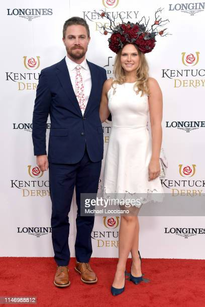 Stephen Amell and Cassandra Jean attend the 145th Kentucky Derby at Churchill Downs on May 04, 2019 in Louisville, Kentucky.