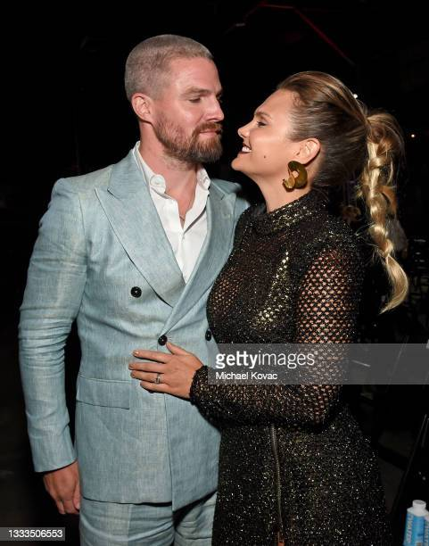 """Stephen Amell and Cassandra Jean attend the after party for the premiere of the new STARZ series """"Heels"""" on August 10, 2021 in Los Angeles,..."""