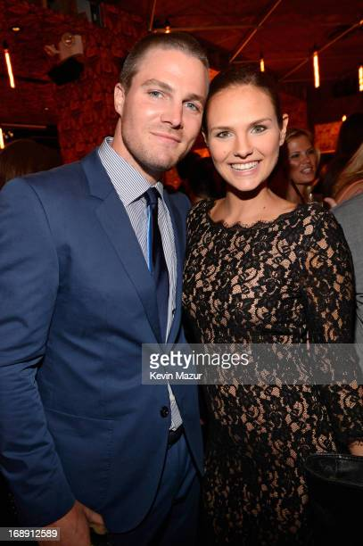 Stephen Amell and Cassandra Jean attend The CW Network's 2013 Upfront party at FINALE on May 16 2013 in New York City