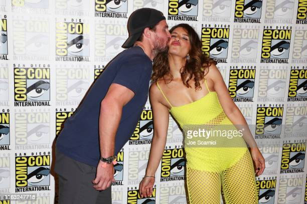 Stephen Amell and Juliana Harkavy attends Arrow press line during 2019 ComicCon International on July 20 2019 in San Diego California