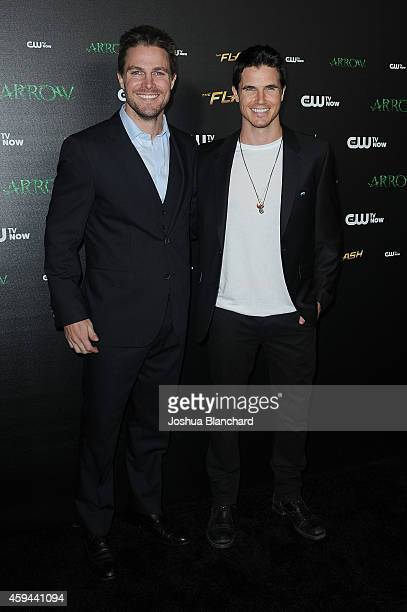 Stephen Amell and Robbie Amell arrive at a special screening for the CW's Arrow And The Flash at Crest Theatre on November 22 2014 in Westwood...