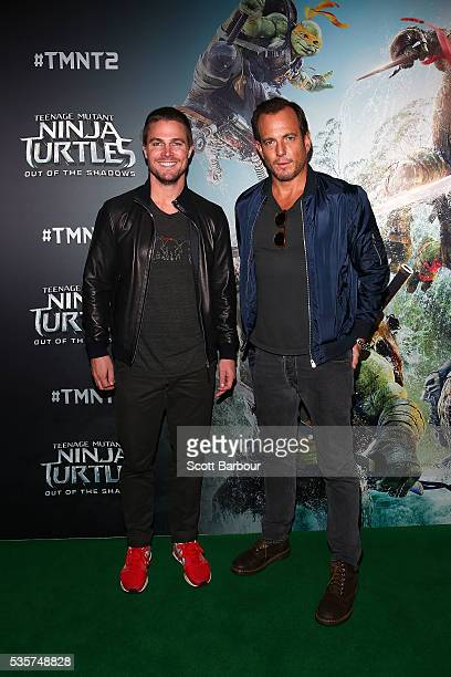 Stephen Amell and Will Arnett attend the Teenage Mutant Ninja Turtles Out of the Shadows fan screening at Village Cinemas Jam Factory on May 30 2016...