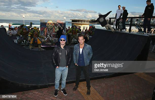Stephen Amell and Will Arnett pose during a photo call ahead of the Australian premiere of Teenage Mutant Ninja Turtles 2 on May 28 2016 in Sydney...