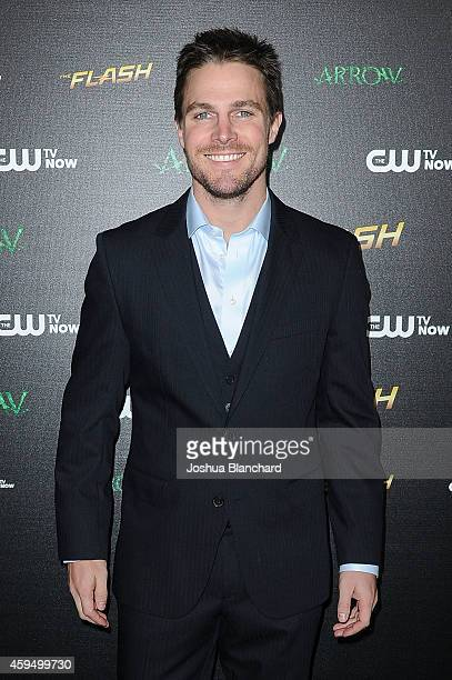 Stephen Amell arrives at a special screening for the CW's Arrow And The Flash at Crest Theatre on November 22 2014 in Westwood California
