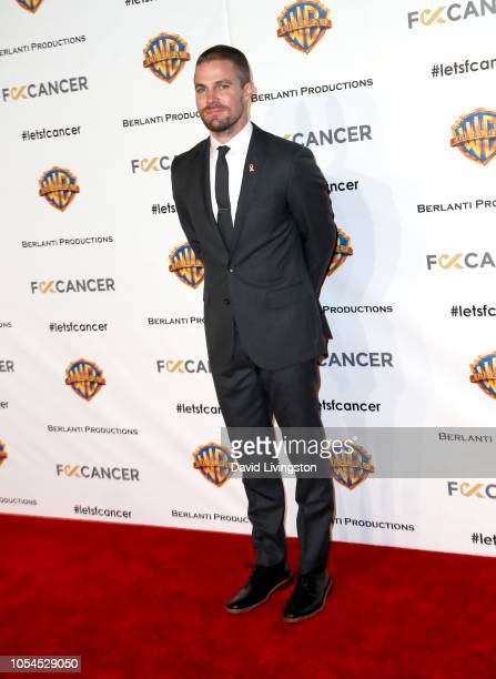 Stephen Amell attends FCancer's 1st Annual Barbara Berlanti Heroes Gala at Warner Bros Studios on October 13 2018 in Burbank California