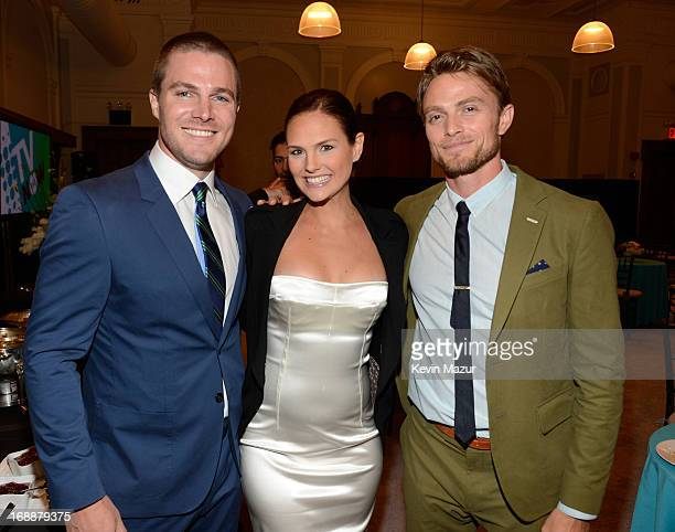Stephen Amell Cassandra Jean and Wilson Bethel backstage at the CW Network's 2013 Upfront at New York City Center on May 16 2013 in New York City
