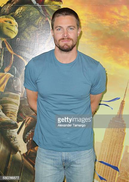 Stephen Amell is seen attending a special fan event at Regal South Beach on behalf of the film 'Teenage Mutant Ninja Turtles Out of the Shadows' on...