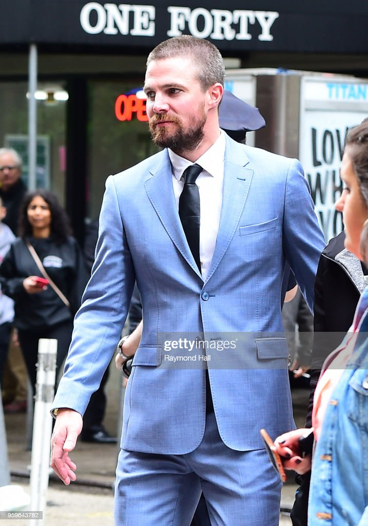 Stephen Amell is seen walking in midtown on May 17, 2018 in New York City.