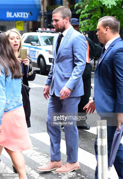 Stephen Amell is seen walking in midtown on May 17 2018 in New York City