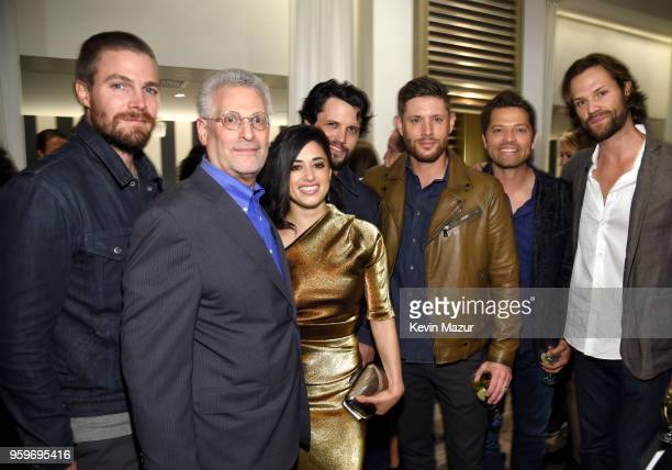 Stephen Amell President of The CW Television Network Mark Pedowitz Jeanine Mason Nathan Parsons Jensen Ackles Misha Collins and Jared Padalecki...