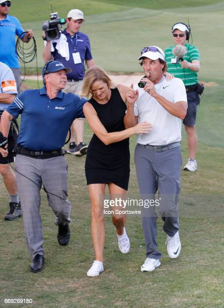 Stephen Ames and his girlfriend Kelly Norcutt head to the scorers table after he won the Mitsubishi Electric Classic tournament at the TPC Sugarloaf...