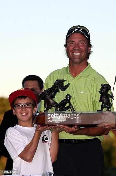 Stephen Ames from Canada and his 10 year old son Ryan hold the winners trophy after winning a playoff in the final round at the Children's Miracle...