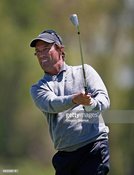 Stephen Ames hits from the 18th fairway during the second round of the 2014 Senior PGA Championship presented by KitchenAid at the Golf Club at...
