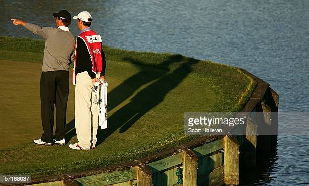 Stephen Ames of Canada and his caddie/brother Robert wait on the 17th green during the final round of The Players Championships on the Stadium Course...