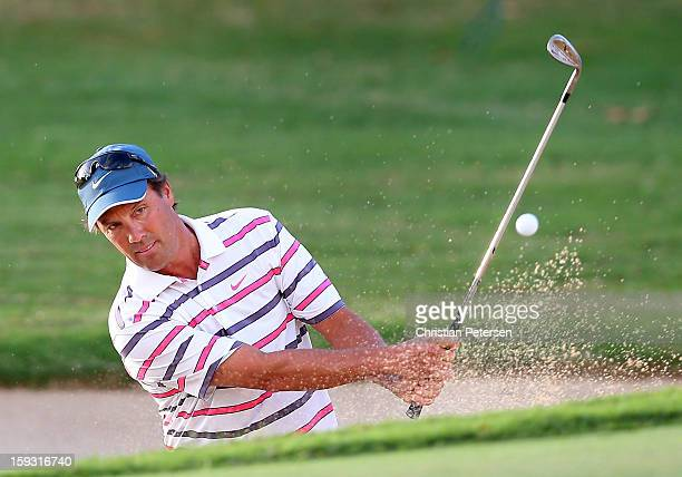 Stephen Ames of Canada chips from the bunker onto the first hole green during the second round of the Sony Open in Hawaii at Waialae Country Club on...