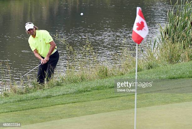 Stephen Ames of Canada chips his ball onto the the 18th green during the final round of the Shaw Charity Classic at the Canyon Meadows Golf Country...