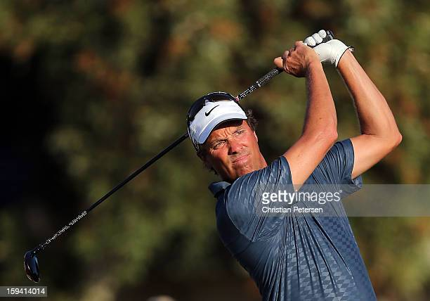 Stephen Ames of Canada hits a tee shot on the 16th hole during the third round of the Sony Open in Hawaii at Waialae Country Club on January 12 2013...