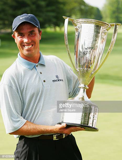 Stephen Ames of Canada holds the trophy after winning the Cialis Western Open July 4 2004 at Cog Hill Golf Club in Lemont Illinois