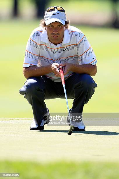 Stephen Ames of Canada lines up a birdie putt on the seventh hole in the second round of the Deutsche Bank Championship at TPC Boston on September 4...