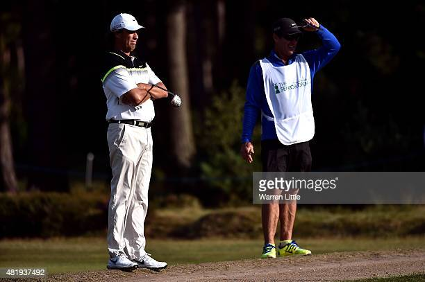 Stephen Ames of Canada stands with his caddie during the third round of The Senior Open Championship on the Old Course at Sunningdale Golf Club on...