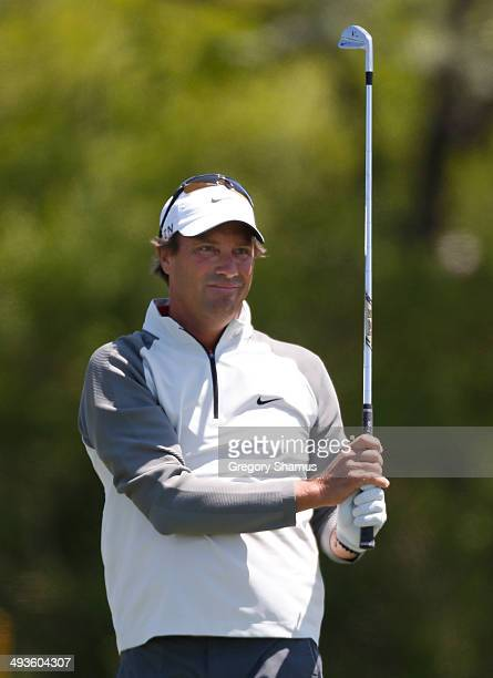 Stephen Ames of Canada watches his tee shot on the fourth hole during the third round of the 2014 Senior PGA Championship presented by KitchenAid at...