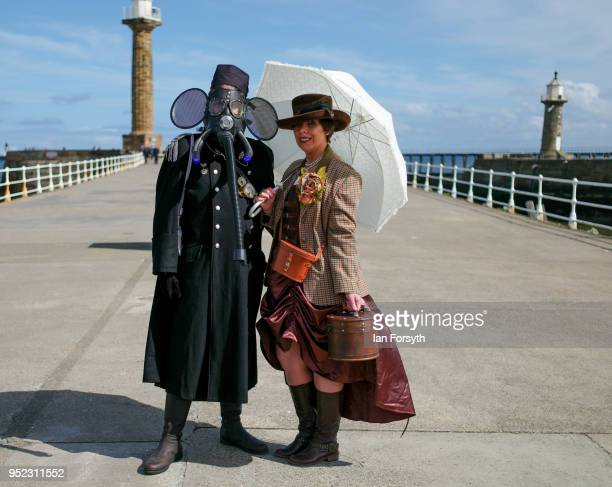 Stephen and Deborah Dutton from Guisborough pose on the pier during Whitby Gothic Weekend on April 28, 2018 in Whitby, England. The Whitby Goth...