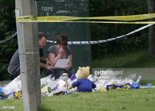 Stephen and Melanie Jones the parents of murdered 11 yearold schoolboy Rhys Jones visit the area where Rhys was killed to read the tributes and lay...