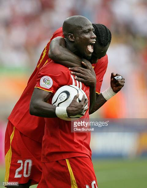 Stephen Appiah and Addo Otto of Ghana celebrate as their team win to secure participation in the next roundduring the FIFA World Cup Germany 2006...